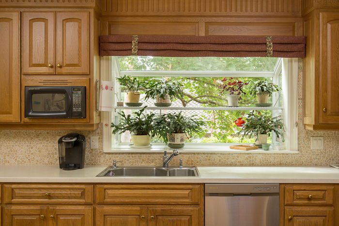 Kitchen with Garden Window Overlooking Backyard