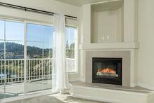 Living room fireplace & lake view