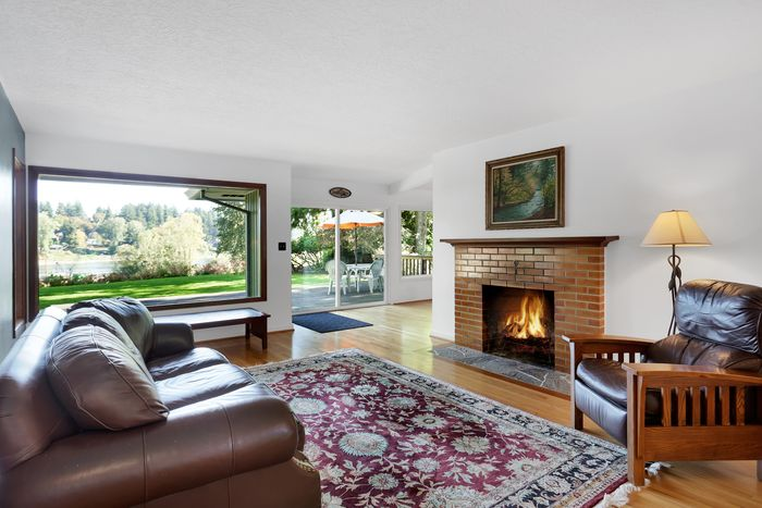 Comfortable living room with cozy fireplace and a view of the river