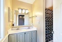 The attached master bath has double sinks and a tub shower. 