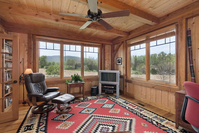 The Ceilings French Doors Lead From Living Room To A Library With Knotty Pine Paneled Walls