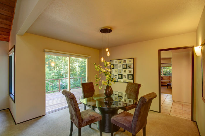 Formal dining room with deck access