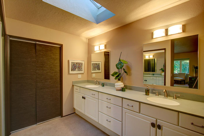 Master bathroom with large closets and skylights