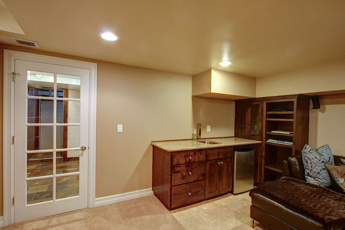 Lower Level Wet Bar with Sink, Fridge & Granite Counter
