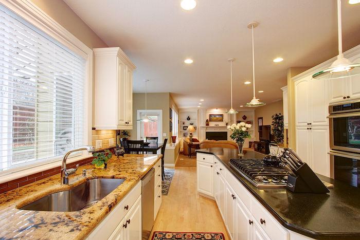 Kitchen with Golden Granite Countertops
