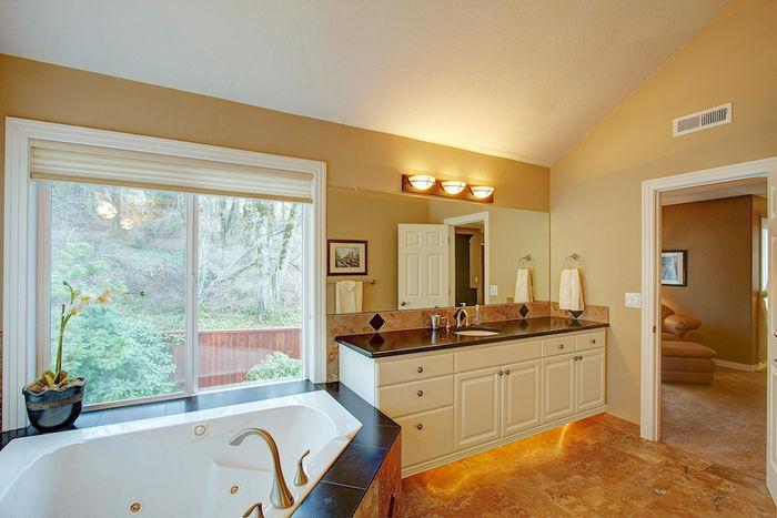 Bright Master Bath with Heated Travertine Floor
