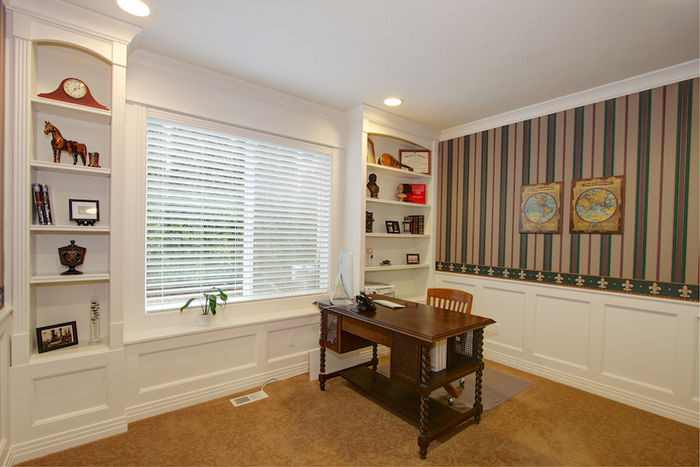 Private Main Floor Office with Built-ins and Wainscot