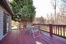 Enjoy the home's beautiful natural setting from the newly stained deck, which is perfect for family meals outdoors and spacious enough for entertaining. Surrounding trees keep it private, but it still gets lots of sunshine.