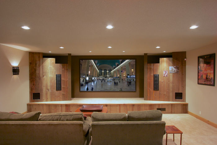 Movie theater with floor lighting, stage, projection entertainment system