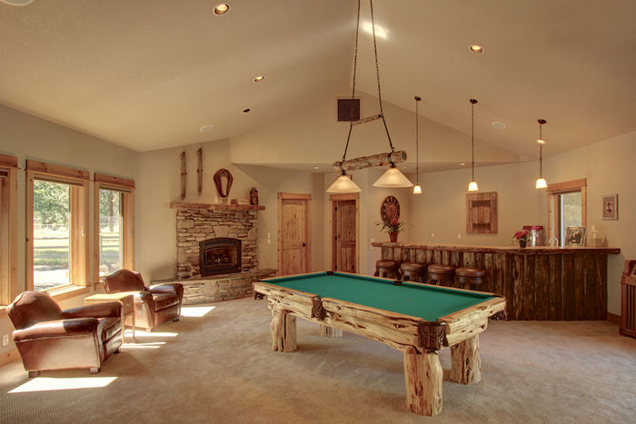 Game/Pool room with wet bar, bathroom & theater access