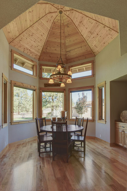 Informal dining room set into a bay window with dome ceiling