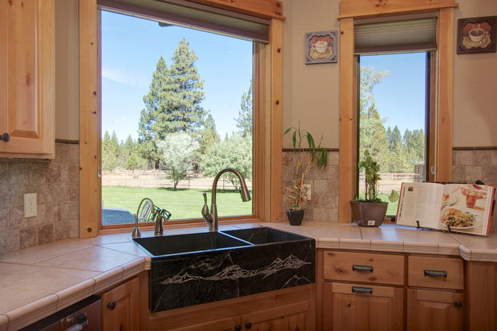 Gourmet kitchen with custom carved granite sink