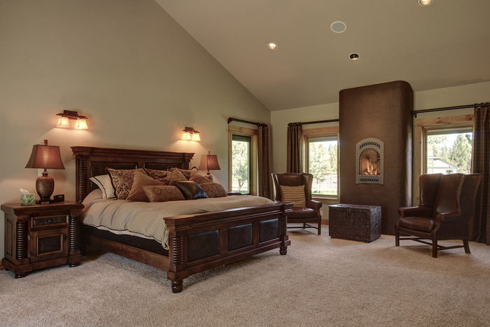 Master suite on main with fireplace and masonry heating