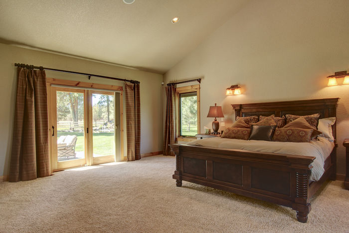 Master suite with patio access and view of water feature