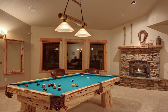 Pool room detail: handcrafted pool table, fireplace