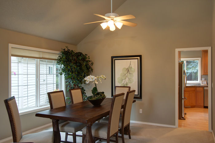 Formal dining room with vaulted ceiling and push-button ceiling fan
