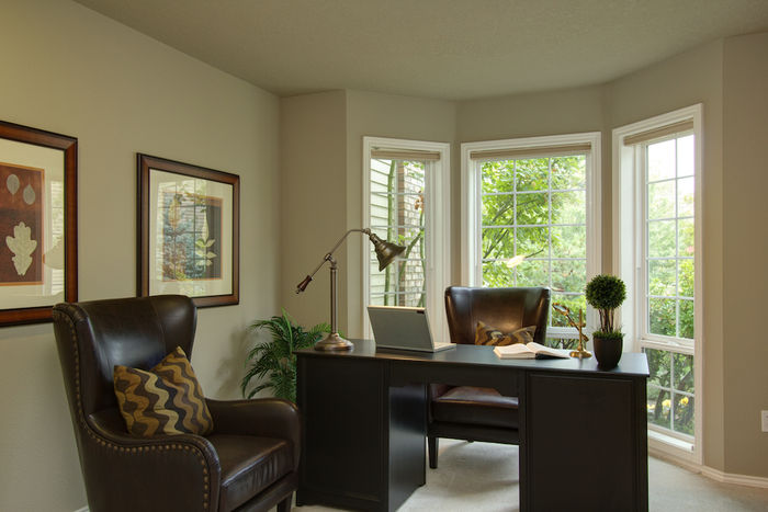 Den/office with bay window and closet