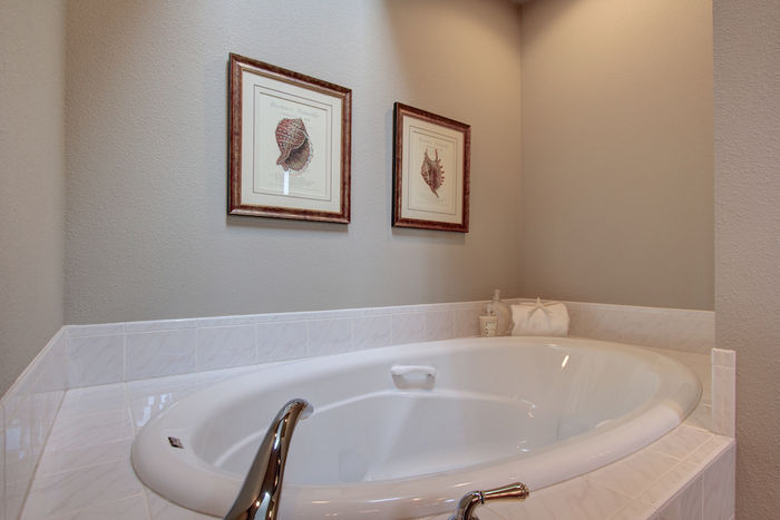 Master bath with large soaker tub beneath a skylight