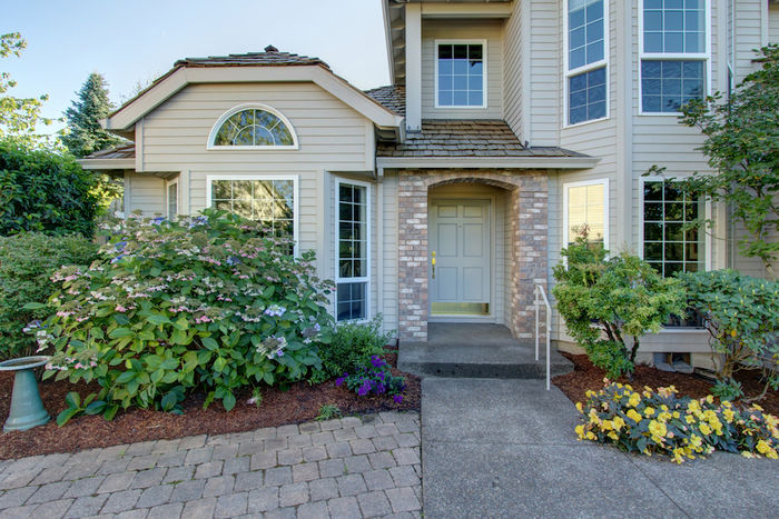 Large patio and beautifully landscaped front yard