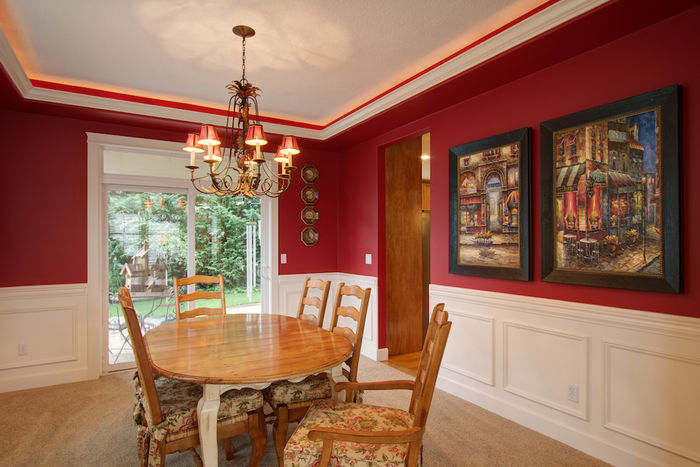 Dining room with uplit recessed ceiling & wainscotting