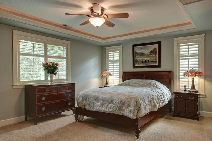 Master bedroom with fireplace & uplit recessed ceiling