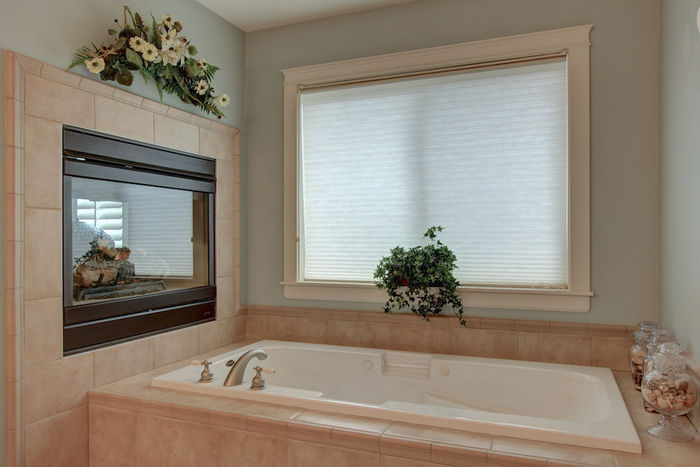 Stunning jetted tub with fireplace in master bath