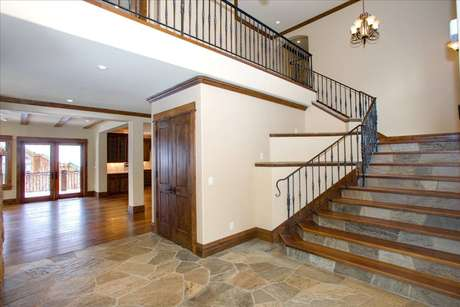 Elegant entry area staircase with iron handrails.