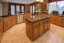 Gourmet kitchen with granite counters, travertine floors, stainless steel appliances
