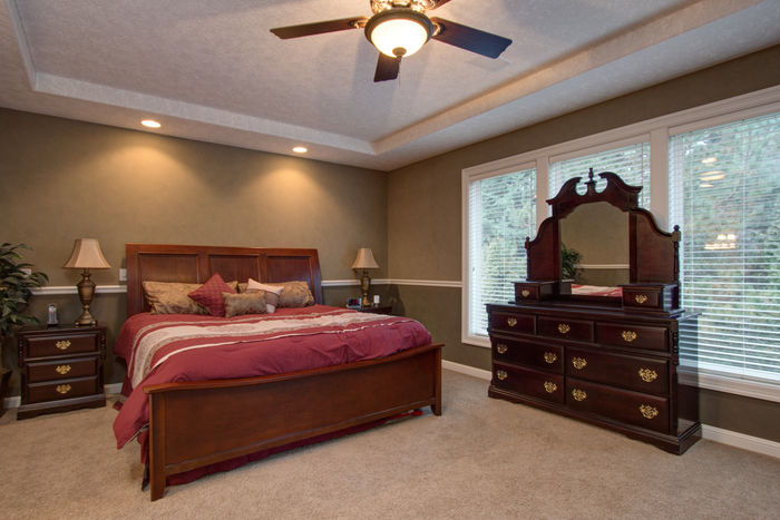 Master suite with recessed ceiling, canned lights, deck access