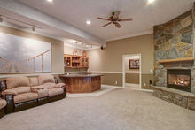 Family room with wet bar, fireplace and slider to patio