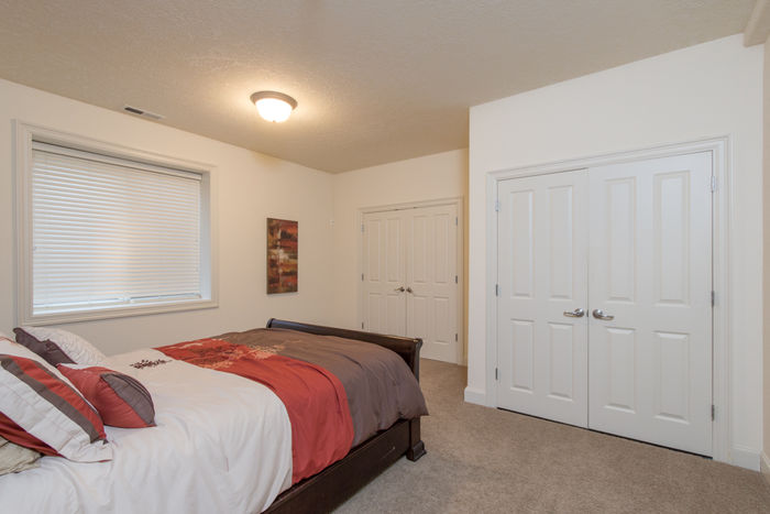 4th bedroom with built-in shelving in closet